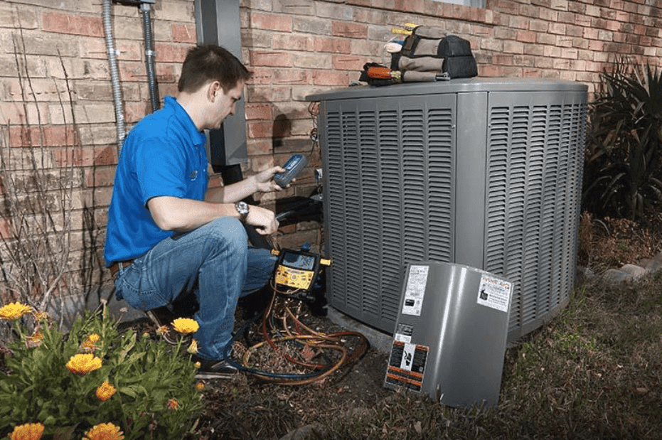 Professional performing AC repair services in Richardson, TX